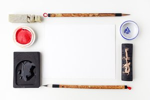 white paper sheet mockup with calligraphy tools. Flat lay. Top view