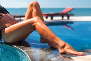 beautiful young slim woman egs sunbathe near the swimming pool