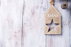 Xmas card with copyspace on white wooden background.
