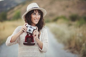 smiling girl with vintage camera