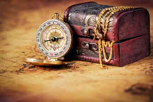Old compass with treasure Chest