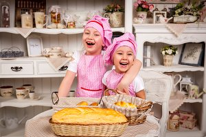 Young cooks with pies