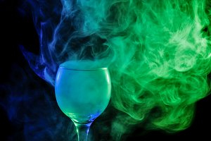 Blue, green smoke in glass.