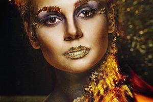Girl with golden makeup. Halloween