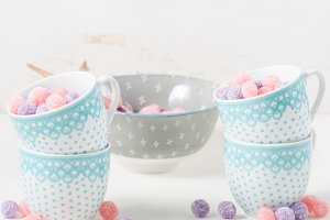 Berry candies in cups. Square