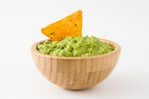 Guacamole in a bowl and nacho