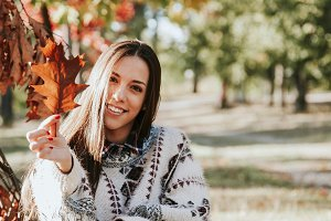 young woman in autumn outdoors
