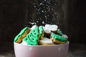 Sugar falling over Christmas cookies