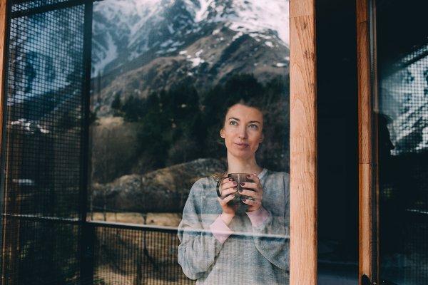 Young woman enjoys tea
