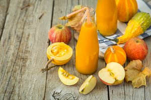 Apple and pumpkin smoothie in glass bottles
