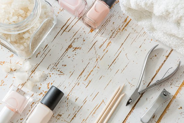 Selection of manicure tools on whit…
