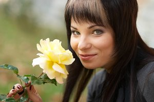 Beautiful girl with yellow rose
