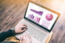 Man working laptop financial report