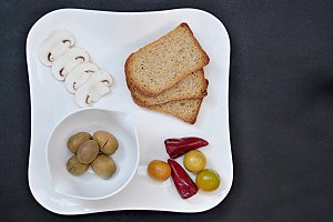 tray with slices bread and others