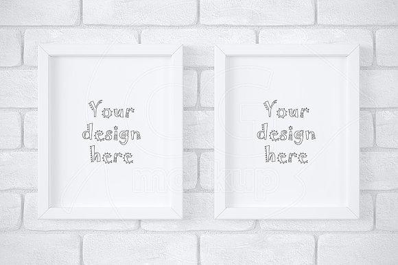 2 white frames on brick wall mockup in Print Mockups