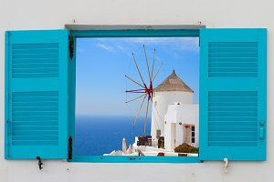 window with windmill of Oia, Santorini