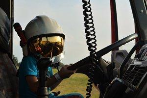 kid in fire truck
