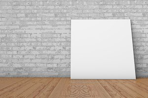 Blank picture against brick wall