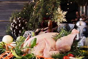 raw chicken with herbs spices ingredients, ready for Christmas