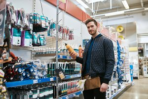 Young handyman shopping in a hardware store