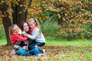 Happy family in autumn park outdoors