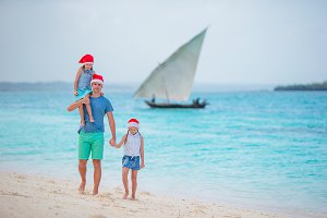 Father with kids on Christmas vacation. Christmas holidays with young family of three enjoying their sea trip