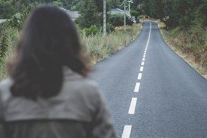 Woman walking alone at dusk