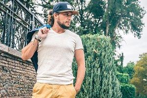 Man in gray T-shirt and Baseball Cap