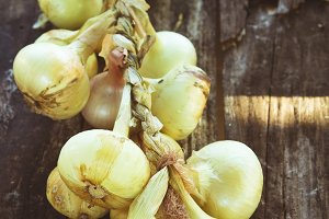 bunch of onions on wood