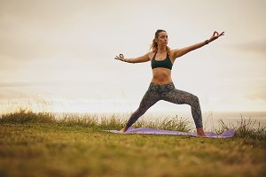 Fit young woman doing yoga
