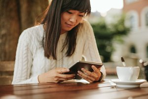Chinese woman using digital tablet