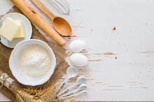 Ingredients for baking - milk, butter, eggs, flour, wheat