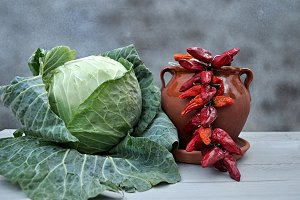cabbage, clay pot and peppers