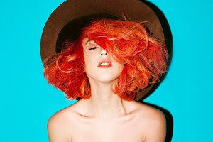 girl in hat and bright red hair