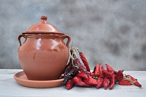 clay pot and chilies peppers