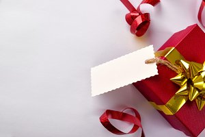Red gift with label hanging composit