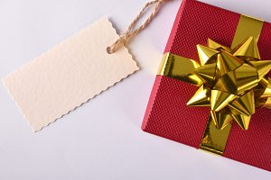Red gift with golden ribbon top