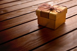 Golden gift on wood elevated view