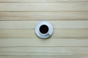 Cup of coffee on wood.
