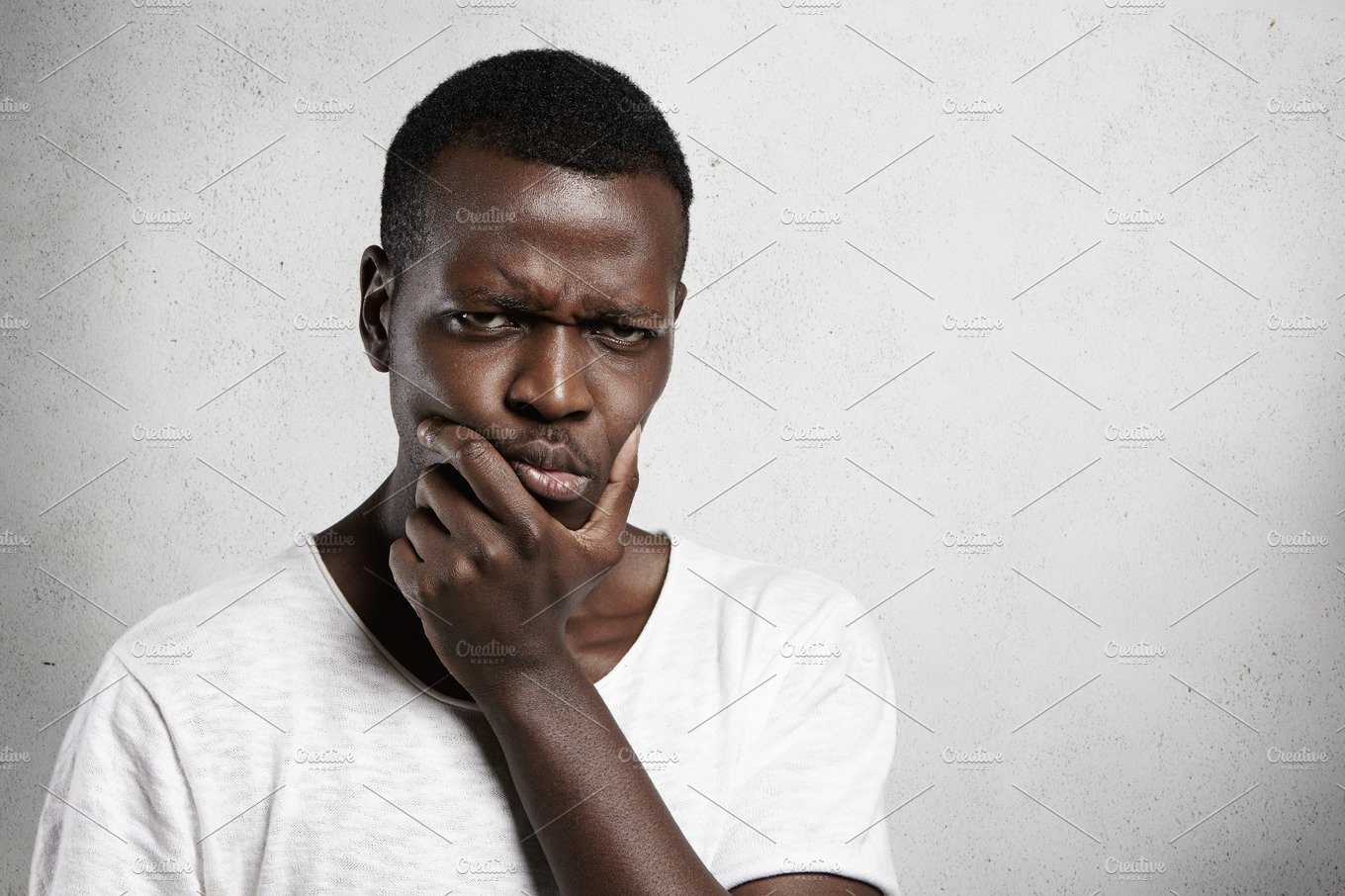 Portrait Of Skeptical African Young Man Looking With