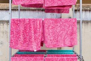 pink towel on clothesline