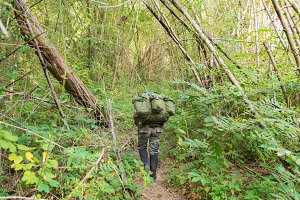soldier or chasseur walk in forest