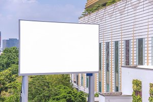 large blank billboard with city