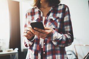 Hipster girl using smartphone