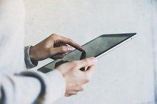 Female hands using digital tablet