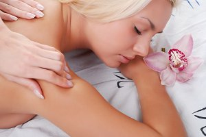 woman take enjoyment in massage
