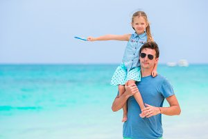 Happy family having fun on white tropical beach