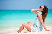 Young beautiful woman enjoying the music on the beach