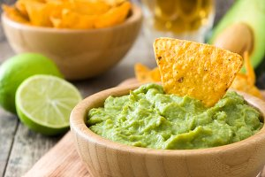 Nachos, guacamole and ingredients