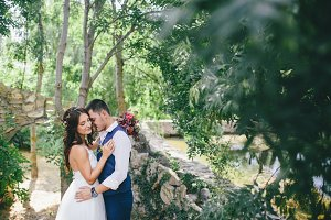 bride and groom hugging outdoors